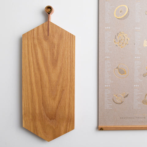 hanger cutting board with mounting post and food safe oil finish - pictured hanging on wall; made in usa by 2nd shift design company | carpenter hill