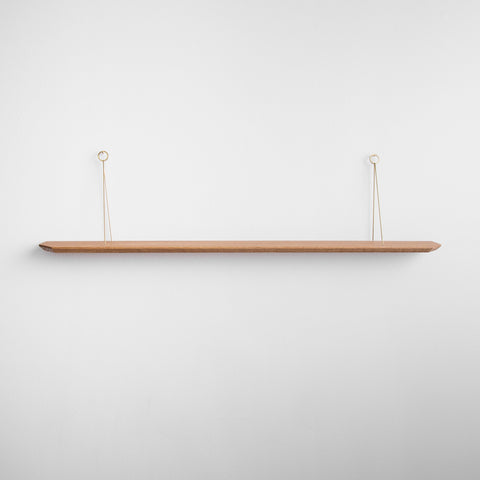 wall hanger shelf - wood with brass hardware - front view hanging on white wall; made in usa by 2nd shift design company | carpenter hill