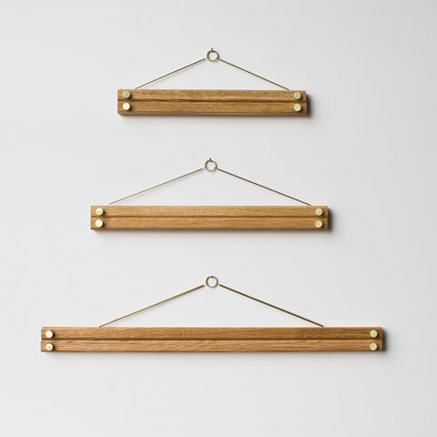 hanger frames for wall mounting pictures - shown in 3 sizes hanging on wall without pictures; made in usa by 2nd shift design company | carpenter hill