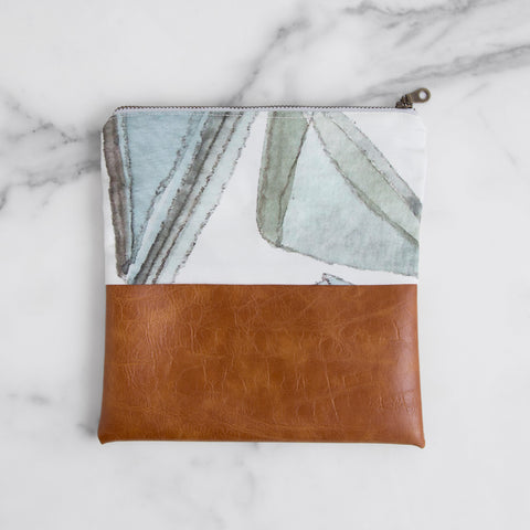 zip pouch - blue jewel - top view on marble slab; made in usa by allie kushnir | carpenter hill