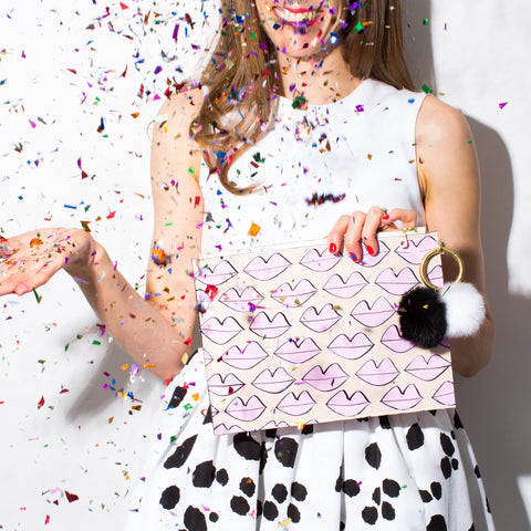 lipstick clutch - blush - held by female and shown with confetti; made in usa by ann howell bullard