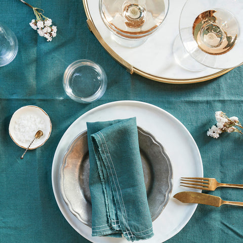 linen napkins - bohemian green - shown folded on table with settings; made in usa by celina mancurti | carpenter hill