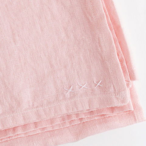 linen tablecloth (boho blush - light pink) - closeup and shown folded; made in usa by celina mancurti | carpenter hill
