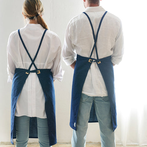 denim bib apron with adjustable straps - view of back shown on both male and female; made in usa by celina macurti | carpenter hill