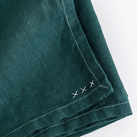 linen tablecloth (boho green) closeup and shown folded; made in usa by celina mancurti | carpenter hill