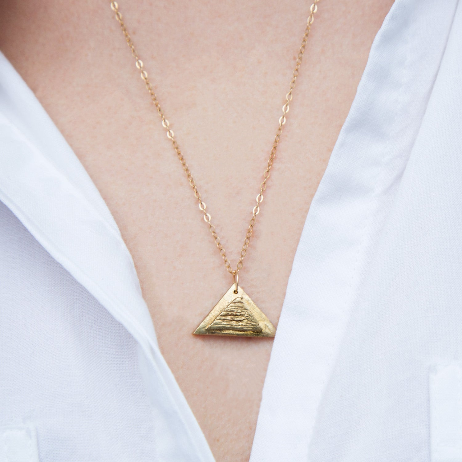 Upclose Triangle Pendant on Model