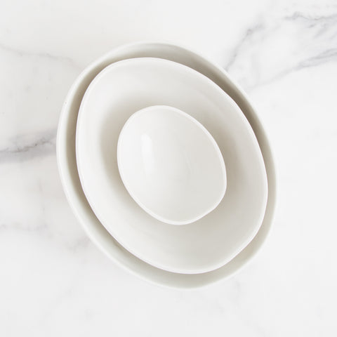 handmade nesting bowls - white porcelain - overhead view shown stacked; made in usa; handmade in atlanta by gold seed | carpenter hill