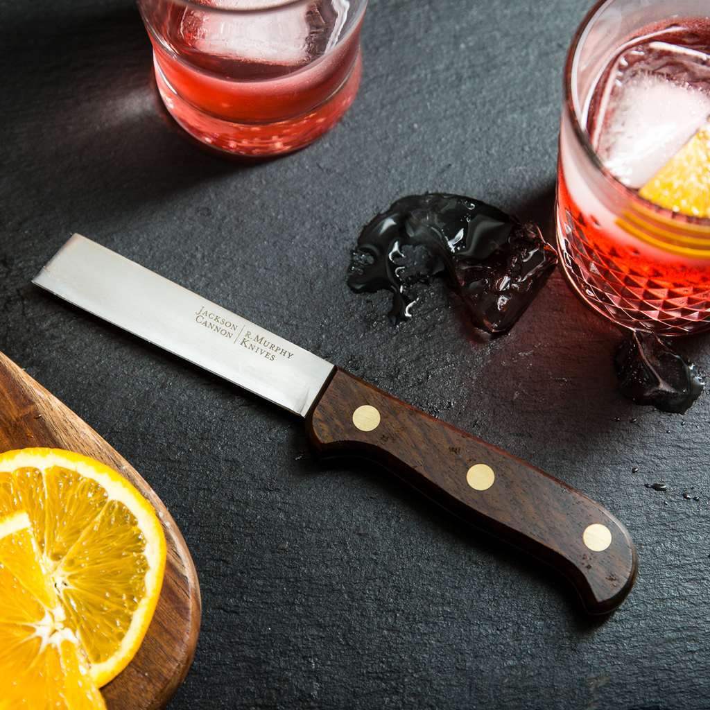 Oranges, lemons and limes on a cutting board