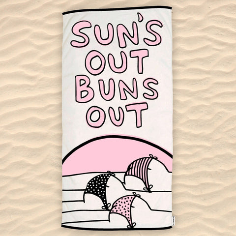 Sun's Out Buns Out Beach Towel in the sand