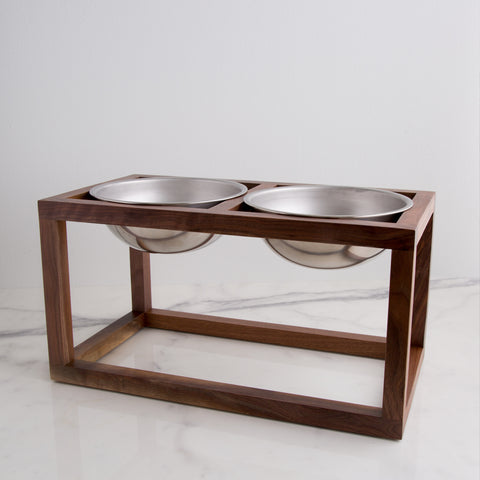modern dog feeder, handmade with walnut wood and heavy duty steel dog bowls - side view shown; made in usa by wake the tree | carpenter hill