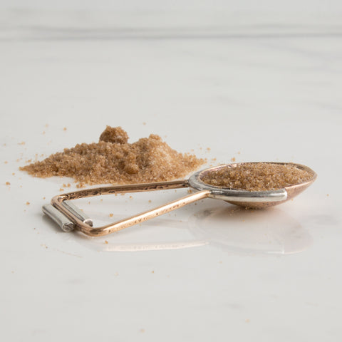 handmade pour over scoop 1 tablespoon - side view on marble slab shown with brown sugar; made in usa by arco | carpenter hill