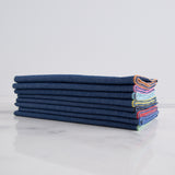 denim napkins with color edge (set of 6) - side view shown folded and stacked laying on marble slab; made in usa by dot and army | carpenter hill