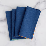 denim napkins with color edge (set of 6) - overhead view shown folded laying on marble slab; made in usa by dot and army | carpenter hill