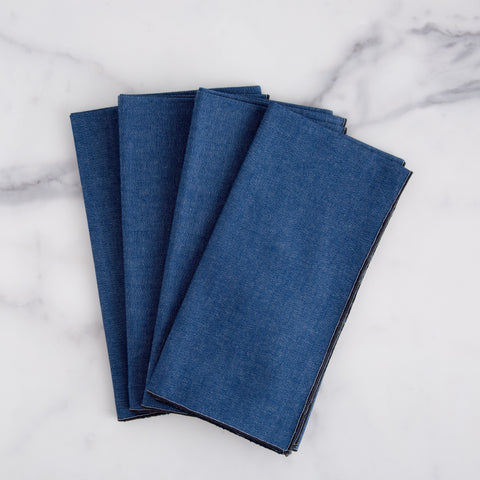 large denim napkins with black edge - overhead view shown folded laying on marble slab; made in usa by dot and army | carpenter hill