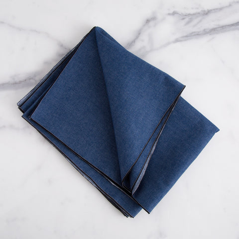 denim table runner - overhead view shown folded on marble slab; handmade in usa by dot and army | carpenter hill