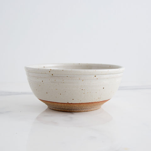 handmade ceramic bowl with aspen glaze; side view on marble counter; made in usa by hanselmann pottery | carpenter hill