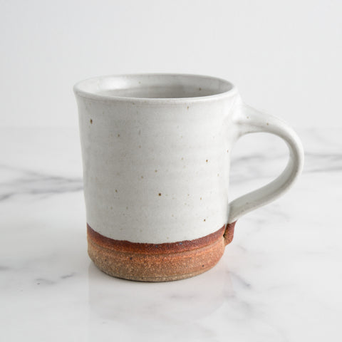 handmade ceramic coffee mug aspen glaze; side view while sitting on marble counter; made in usa by hanselmann pottery | carpenter hill