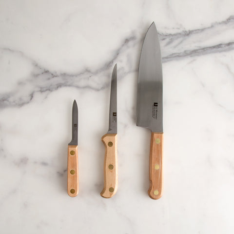 "3 piece knife set laying flat on marble table - top view; made in USA by R. Murphy; 8"" Chef Knife, 5"" Fillet Knife and Paring Knife"