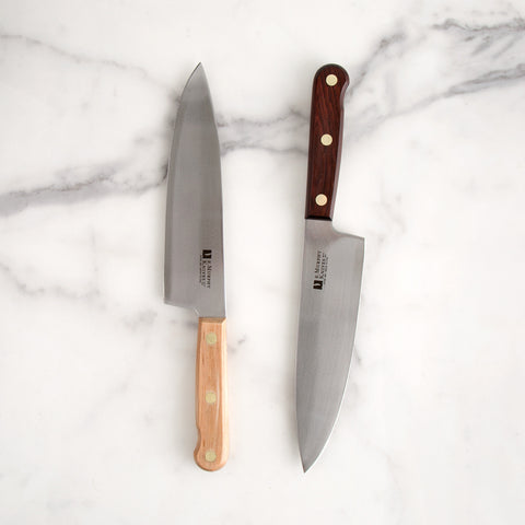8 inch chef knife with maple handle laying flat on marble with rosewood comparison - top view; made in USA by r. murphy