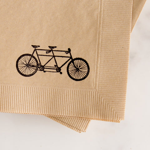 hand stamped napkins with tandem bike - closeup view from above while laying on marble slab; made in usa of recycled paper by with love + ink | carpenter hill
