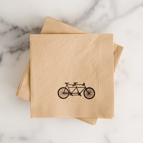 hand stamped napkins with tandem bike - view from above while laying on marble slab; made in usa of recycled paper by with love + ink | carpenter hill
