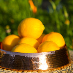 copper resonance floating dish with lemons