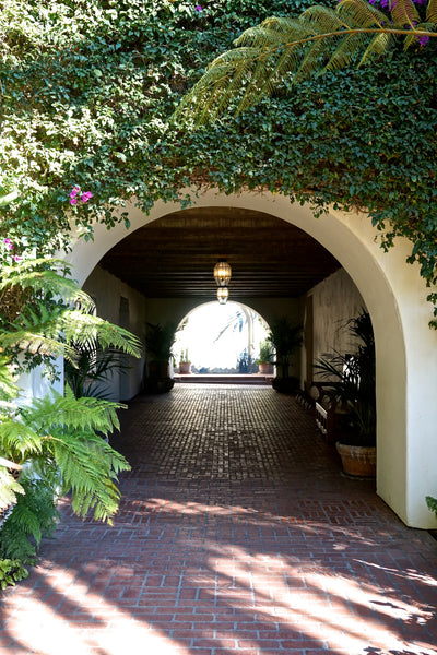 Mediterranean Arched entryway in Santa Barbara  red tile terra cora roof in Santa Barbara- DLG Lighting Co.