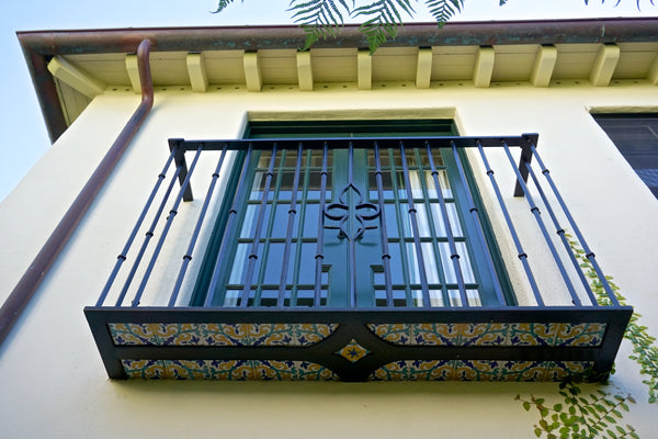 Biltmore Hotel Santa Barbara balcony with wrought iron railings- DLG Lighting Co.