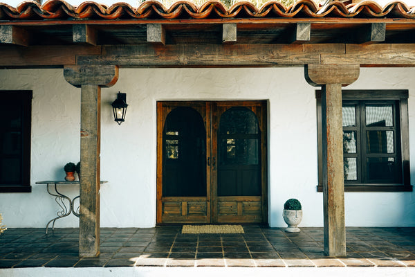 courtyard hacienda with terra-cotta tiles and wrought iron lights