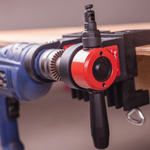Load image into Gallery viewer, The CaNibble nibbler tool in bench mounted clamps.