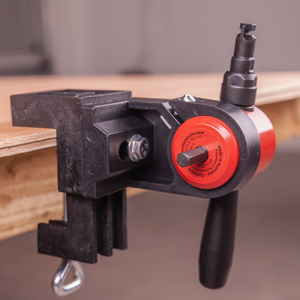 The CaNibble Nibbler mounted in one of it's bench clamps