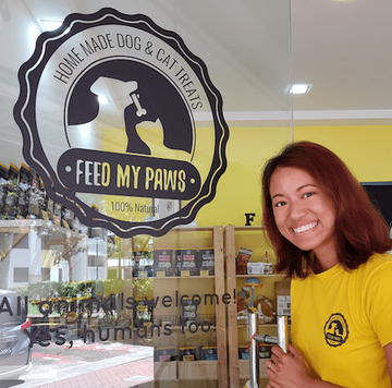 Crystle from Feed My Paws at the doorway of the Toa Payoh Outlet