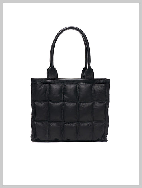 Black designer bag made from reclaimed leather by Lilla Lane. The Burlain Sake Small