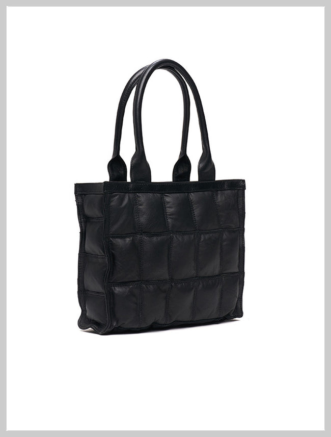 Black designer handbag made from reclaimed leather by Lilla Lane. The Burlain Sake Small