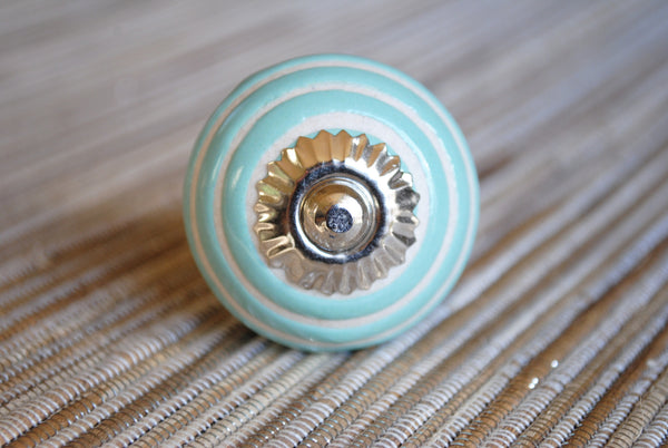 White with Teal Circles