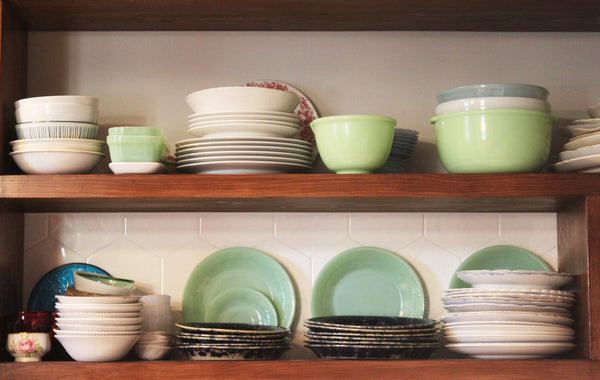 jadeite and vintage dishes on open kitchen shelving