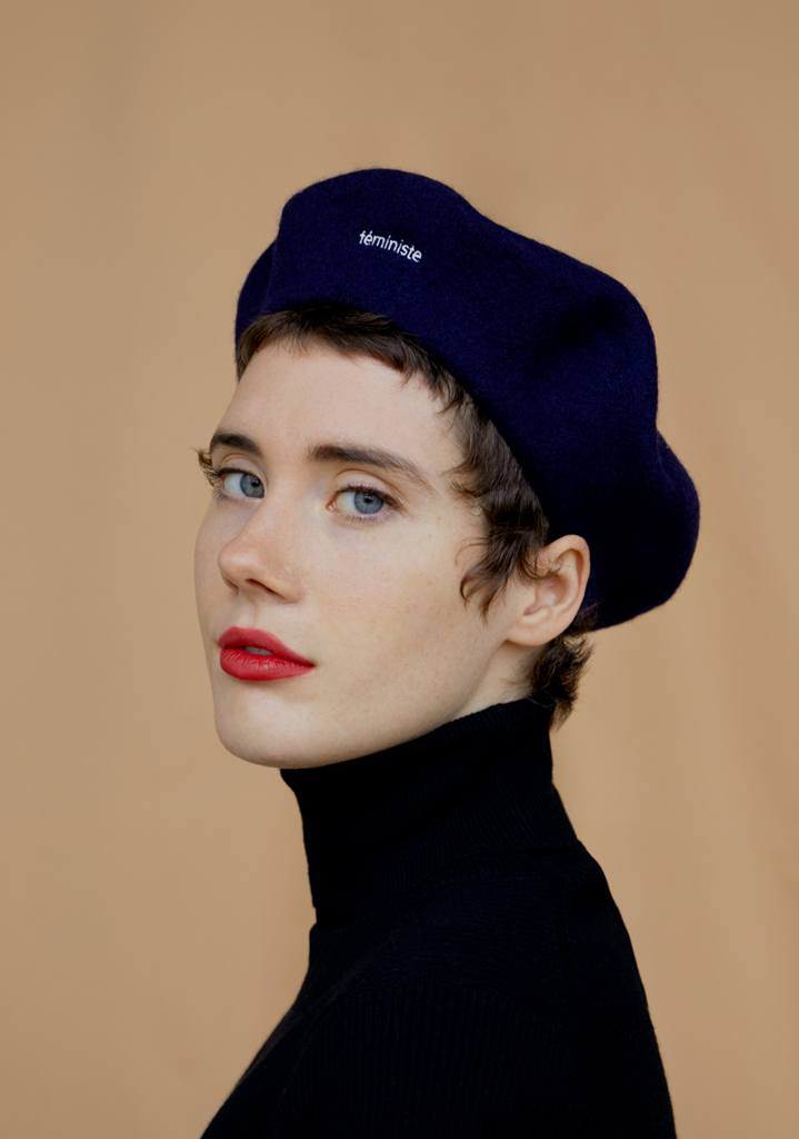 person wearing feministe beret, facing front