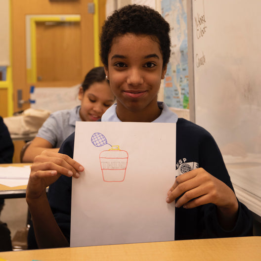 A student shows their entry to the design contest.