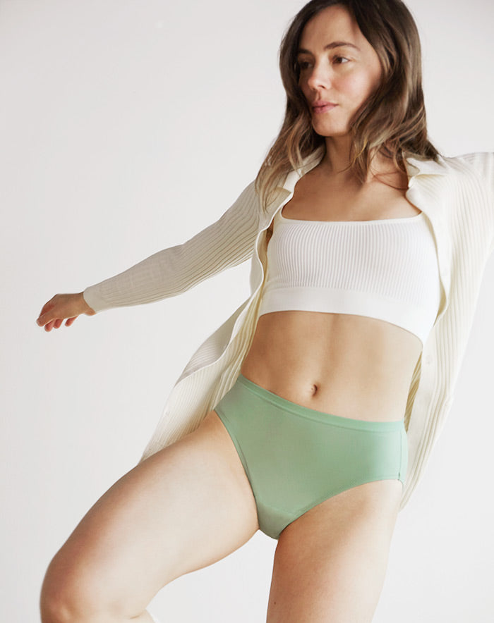Seated person wearing Speax absorbent underwear.