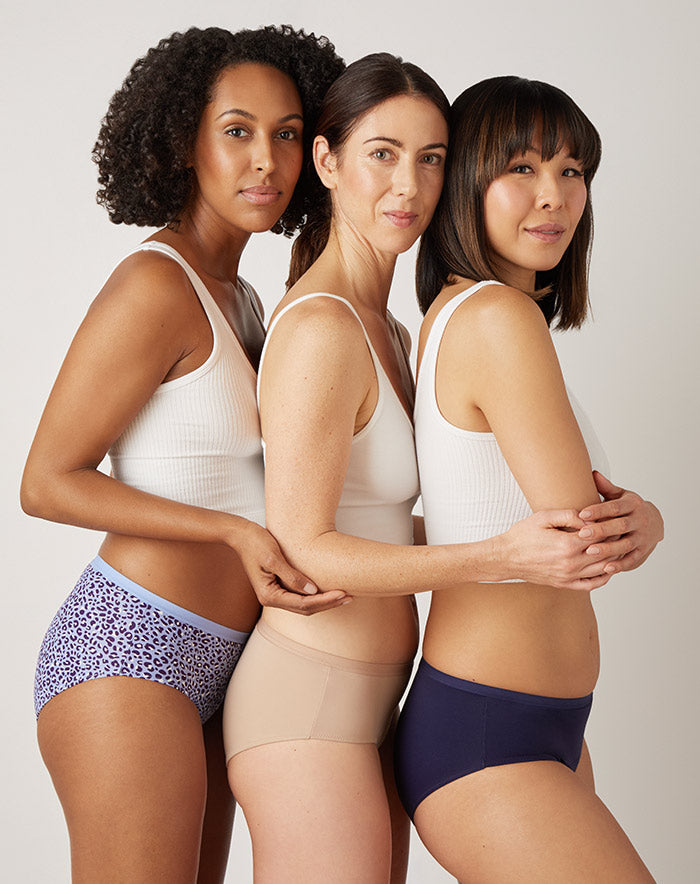 Three people wearing Speax absorbent underwear.