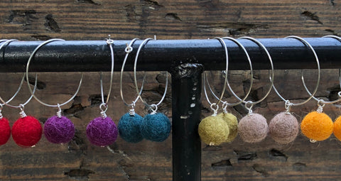 Sterling hoop pompom earrings