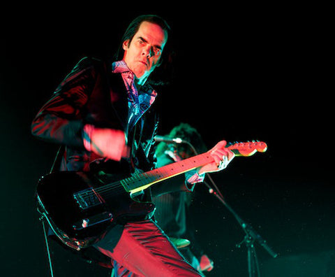 Nick Cave playing his black Fender Strat