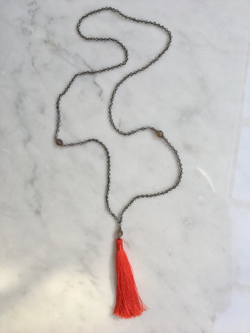 THE GIRL WITH THE RED TASSEL NECKLACE