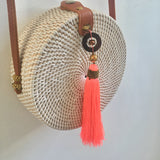 CROSS BODY RATTAN TASSEL BAG CORAL ISLAND