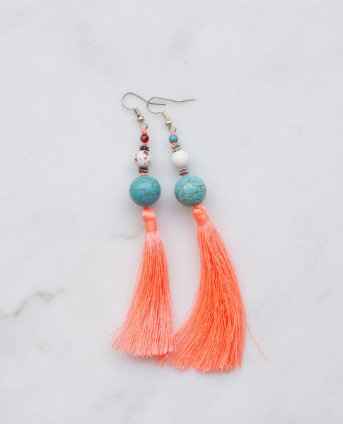 Hot coral tassel earrings with large turquoise stone