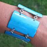 Blue cuff bracelet on an arm