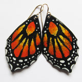 Close-up of butterfly earrings