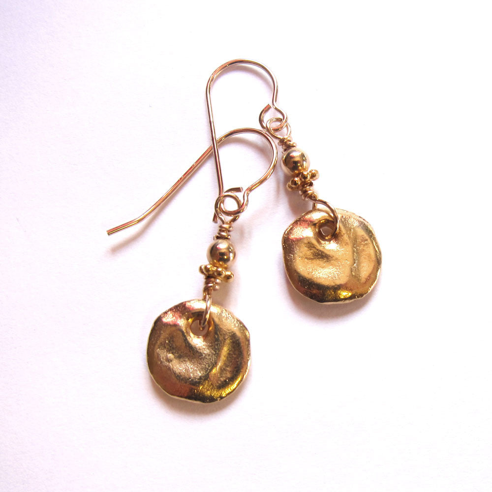 Tiny gold dangle earrings on gold wires