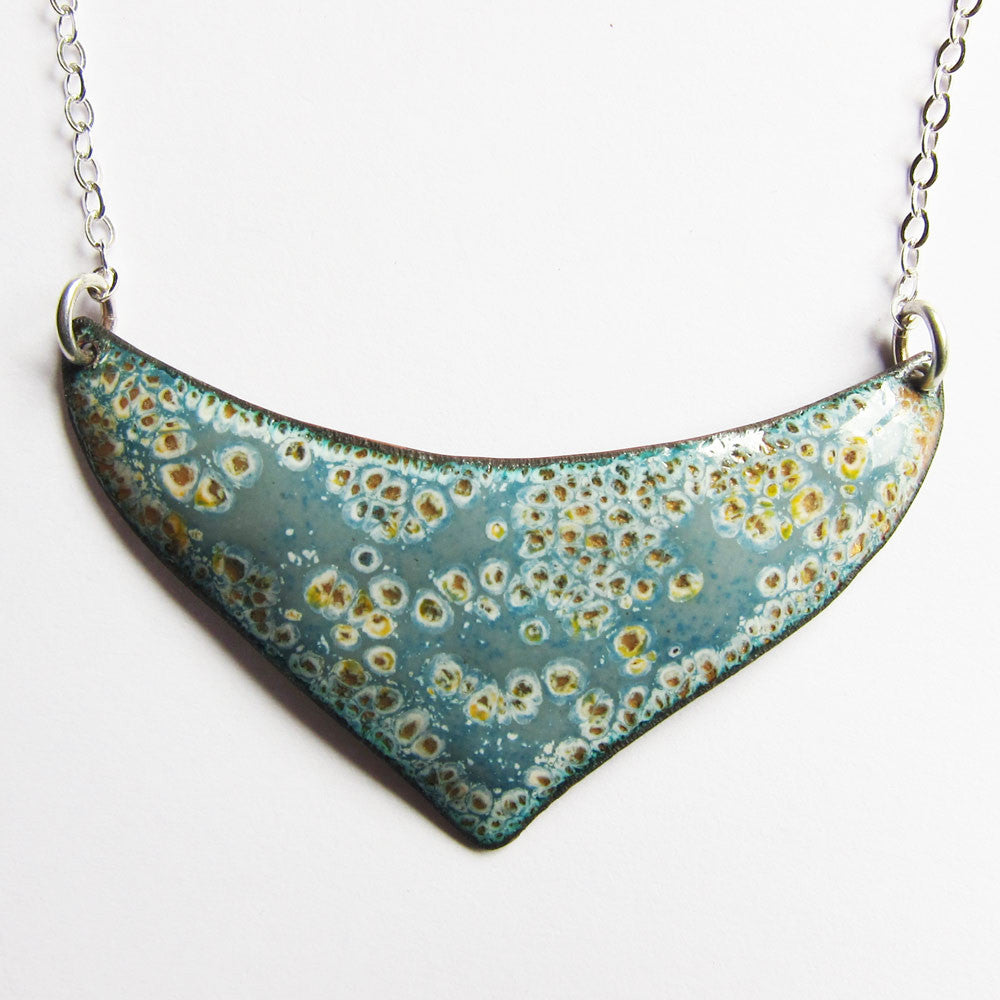 Close-up of blue and gray enamel bib necklace