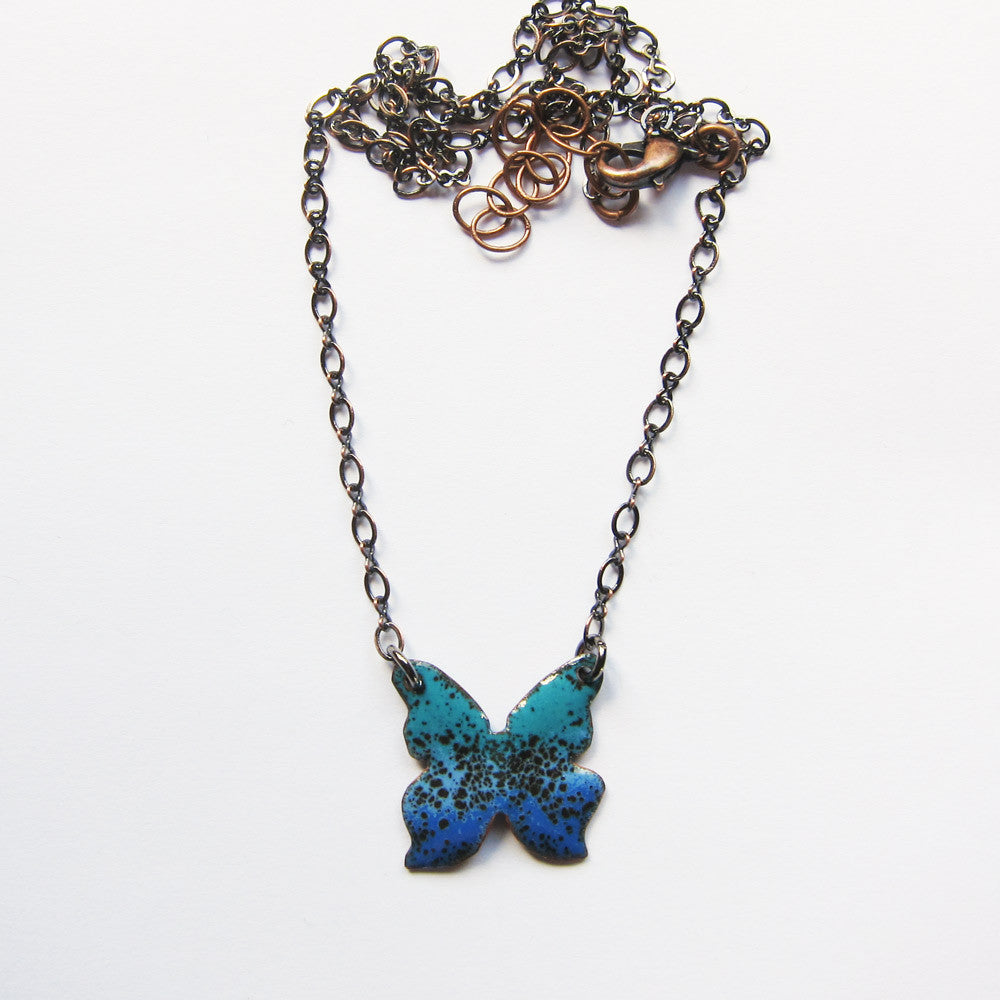 Tiny blue butterfly necklace